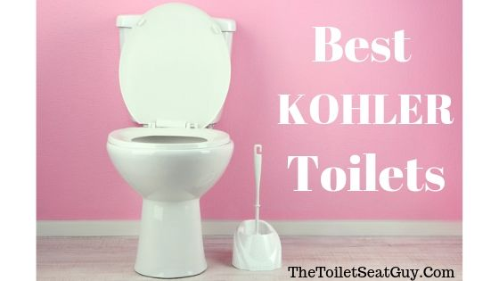 White Toilet In Front Of Pink Wall